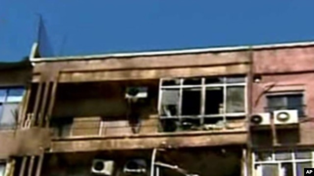 In this photo released by the Syrian official news agency SANA, damaged apartments are seen after a clashes between the Syrian rebels and the Security forces, in the Mazzeh neighborhood of Damascus, Syria, on Monday, March 19, 2012.