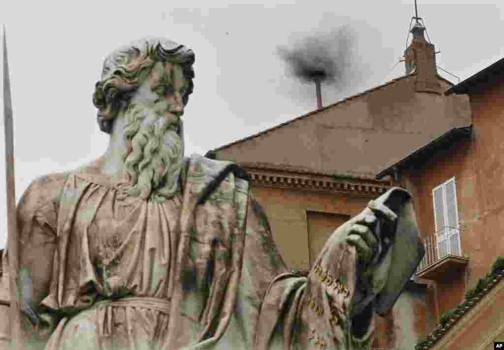 Black smoke emerges from the chimney on the Sistine Chapel as cardinals voted on the second day of the conclave to elect a pope in Saint Peter's Square at the Vatican, March 13, 2013.