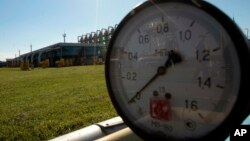 FILE - This Wednesday May 21, 2014 file photo shows a gas pressure gauge in Bil 'che-Volicko-Ugerske underground gas storage facilities in Strij, outside Lviv, Ukraine. Russia on Monday, June 16, 2014