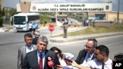 Philip Kosnett, the U.S. Embassy Charge d'Affaires, talks to members of the media after attending the trial of jailed US pastor Andrew Craig Brunson at a court inside the prison complex in Aliaga, Izmir province Wednesday, July 18, 2018.
