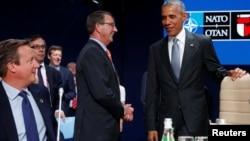 Дэвид Камерон, Барак Обама, Эштон Картон. на одном из заседаний саммита НАТО в Варшаве. Польша. 9 июля 2016 г.