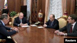 Russia's President Vladimir Putin, second from left, Foreign Minister Sergei Lavrov, left, Director of Russian Federal Security Service Alexander Bortnikov, second from right, and Director of Foreign Intelligence Service Sergei Naryshkin hold a meeting at the Kremlin in Moscow, Dec. 19, 2016.