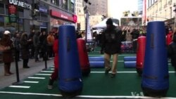 Times Square Becomes Football Street Fair