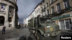 FILE - Belgian soldiers patrol in the neighborhood of Molenbeek, in Brussels, Belgium, Nov. 22, 2015, after security was tightened in Belgium following the fatal attacks in Paris.