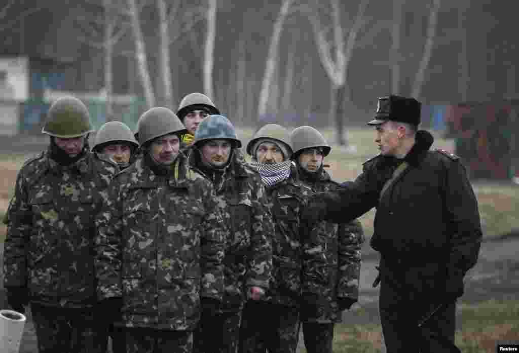 "Members of a ""Maidan"" self-defense battalion take part in a training exercise at a Ukrainian Interior Ministry base near Kyiv, March 17, 2014."
