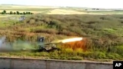 A rocket fired by Syrian rebels at Mannagh air base in Aleppo province, Syria, May 13, 2013 (Ugarit News)