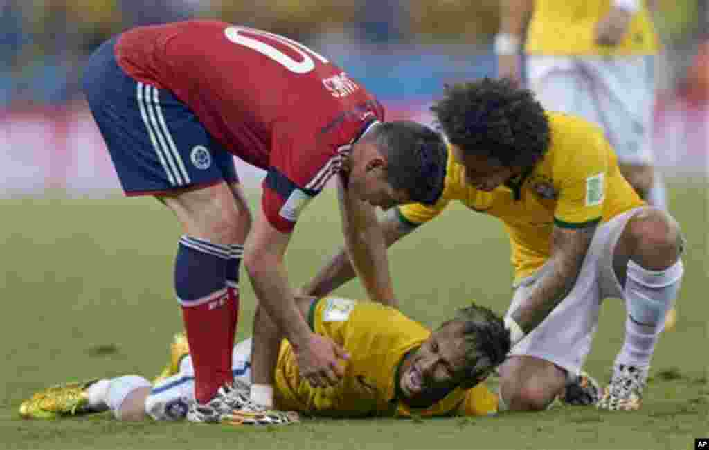 Brazil's Neymar screams out after being fouled during the World Cup quarterfinal soccer match between Brazil and Colombia at the Arena Castelao in Fortaleza, Brazil, Friday, July 4, 2014. Brazil's team doctor says Neymar will miss the rest of the World Cu