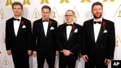 Left to right, Jan Sperling, Emmanuel Prevenaire, Etienne Brandt and Tony Postiau, developers of the Flying-Cam SARAH 3.0 system and recipients of a Scientific and Engineering Award, pose together at the Academy of Motion Picture Arts and Sciences' annual Scientific and Technical Awards on Saturday, Feb. 15, 2014, in Beverly Hills, California.