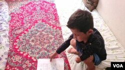 Fazel Ahmed, 9, lost his arm in a mortar attack in Afghanistan, but his family did not flee until the Taliban took over his region this summer on April 13, 2021 in Van, Turkey. (Heather Murdock/VOA)