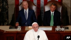 Pope Francis addresses Congress. Representative John Boehner sits on the right and wears a green tie. Vice President Joe Biden sits on the left.