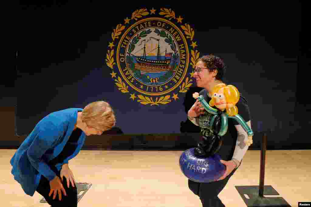 Democratic 2020 presidential candidate and Senator Elizabeth Warren (D-MA) reacts as Naomi Greenfield carries a balloon figure of Warren at a GOTV campaign event in Nashua, New Hampshire, Feb. 5, 2020.