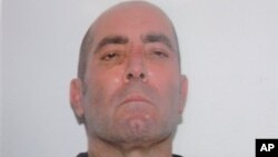"""Profil pemimpin kartel narkoba Meksiko """"Gulf Cartel"""", Mario Armando Ramirez Trevino diperlihatkan dalam konferensi pers di Mexico City (18/8). Ramirez Trevino ditangkap tanggal 17 Agustus 2013 dalam sebuah operasi militer di dekat perbatasan Texas."""
