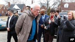 Democratic presidential candidate Sen. Bernie Sanders, I-Vt., visits outside a polling location at Bow Elementary in Detroit, March 10, 2020.