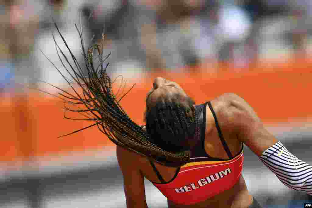Belgium's Nafissatou Thiam competes in the Women's High Jump qualification round during the European Athletics Championships at the Olympic stadium in Amsterdam.