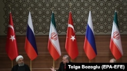 TURKEY -- Turkish President Recep Tayyip Erdogan (C), Russian President Vladimir Putin (R) and Iranian President Hassan Rohani attend a press conference after their meeting at the Presidential Palace in Ankara, April 4, 2018