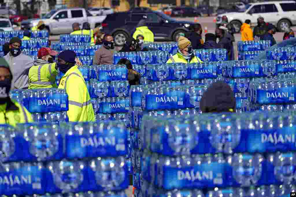 Water to be loaded into vehicles is stacked at a City of Houston water distribution site. The location was set up to provide bottled water to individuals while the city remains on a boil water notice or because of frozen pipes at home.