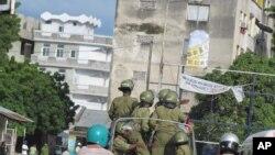 Polisi wakipiga doria katikia mitaa ya Zanzibar