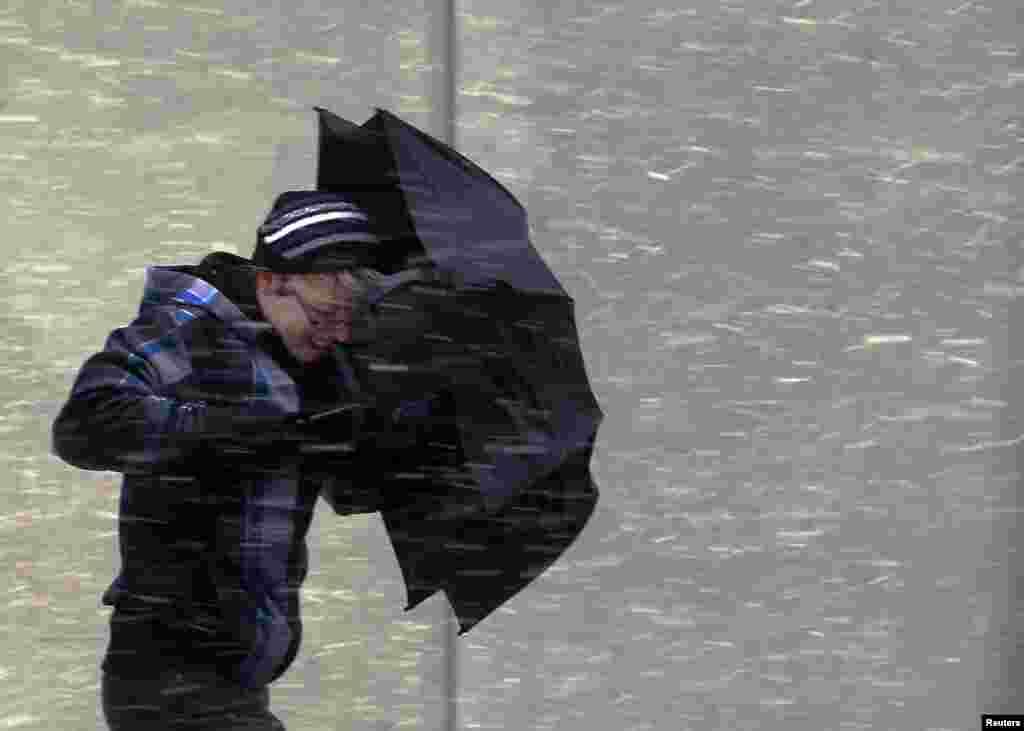 A pedestrian walks into wind-driven snow in Boston, Massachusetts, Feb. 8, 2013.