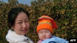 多美滋结石宝宝母亲蒋亚林和女儿