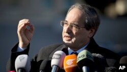 FILE - Syrian Deputy Foreign Minister Faisal Mekdad gestures as he talks to journalists.