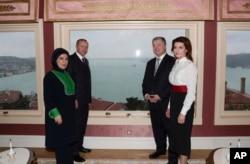 Turkey's President Recep Tayyip Erdogan, second from left, his wife Emine Erdogan, left, Ukraine's President Petro Poroshenko and his wife Maryna Proshenko pose for a photo before a meeting, in Istanbul, Saturday, Jan. 5, 2019.