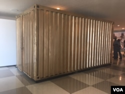 The refurbished shipping container/portal will remain at the U.N. public lobby in New York for 3 months, allowing visitors to connect with Syrian refugees. (M. Besheer/VOA)