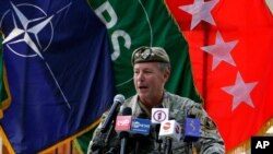 U.S. Army Gen. Scott Miller, the top U.S. commander in Afghanistan, speaks at a ceremony where he relinquished his command, at Resolute Support headquarters, in Kabul, Afghanistan, July 12, 2021.