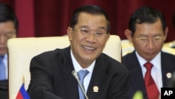 Cambodian Prime Minister Hun Sen spoke to the lower house of parliament in a nationally televised speech Thursday, Aug. 9, 2012, that was mandatory viewing for civil servants.