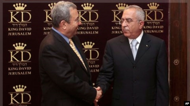 Israeli Defense Minister Ehud Barak, left, shakes hands with Palestinian Prime Minister Salam Fayyad (file photo).