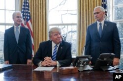 President Donald Trump, flanked by Health and Human Services Secretary Tom Price (left) and Vice President Mike Pence, told members of the media Friday that with the collapse of the health care overhaul bill, he would turn his attention to tax reform.