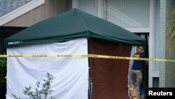 Nhân viên FBI vào căn hộ của Ibragim Todashev trong thành phố Orlando, tiểu bang Florida, 22/4/13