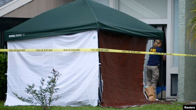 FBI agency enters the apartment of Ibragim Todashev, 27, in Orlando, Florida, May 22, 2013.