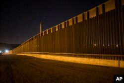 A portion of the new steel border fence stretches along the US-Mexico border in Sunland Park, New Mexico, March 30, 2017.