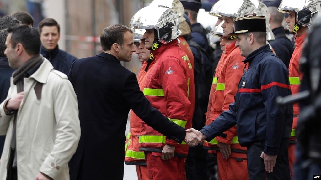 Macron Tours Damaged Arc de Triomphe after Paris Hit by Riot