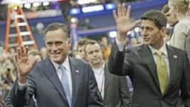 Republican presidential nominee Mitt Romney (l) and his vice presidential running mate Rep. Paul Ryan at the Republican National Convention in Tampa, Aug. 30, 2012.