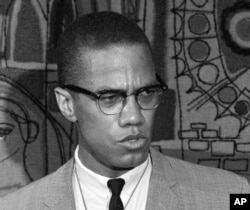 FILE - Malcolm X addresses reporters at what was then known as the Park Sheraton Hotel in New York, March 12, 1964.