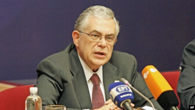 Greek Prime Minister Lucas Papademos holds a news conference after a European Union summit in Brussels, January 31, 2012.