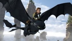 "Toothless, a Night Fury Dragon – the rarest of all kind – soars through the sky with Hiccup (Jay Baruchel) on his back in ""How to Train Your Dragon"""