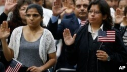 FILE - Immigrants take the citizenship oath during naturalization ceremonies at a U.S. Citizenship and Immigration Services ceremony in Los Angeles, California, Sept. 20, 2017.