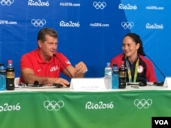 Coach Geno Auriemo and Sue Bird, captain of the U.S. women's Olympic basketball team, speak with reporters in Rio de Janeiro, Brazil, Aug. 20, 2016. (P. Brewer/VOA)