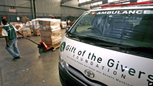 A worker pulls a trolley containing supplies to be donated to the people in need by Gift of the Givers, a South African humanitarian aid organization, at a warehouse in Johannesburg, South Africa, January 21, 2009 (file photo)