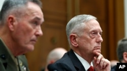 Joint Chiefs Chairman Gen. Joseph Dunford (left) and Defense Secretary Jim Mattis listen to a question as they testify at a House Armed Services Committee hearing on the defense budget.