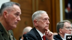 Joint Chiefs Chairman Gen. Joseph Dunford, left, Defense Secretary Jim Mattis, and Defense Under Secretary and Chief Financial Office David Norquist, listen to a question as they testify at a House Armed Services Committee hearing on the FY'18 defense bud