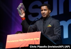 "FILE - Nate Parker, the director, star and producer of ""The Birth of a Nation,"" accepts the U.S. Dramatic Audience Award for the film during the 2016 Sundance Film Festival Awards Ceremony in Park City, Utah, Jan. 30, 2016."