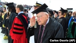 FILE - World War II veteran Bob Barger received his associate's degree from the University of Toledo at the age of 96 on May 5, 2018. (AP Photo/Carlos Osorio)