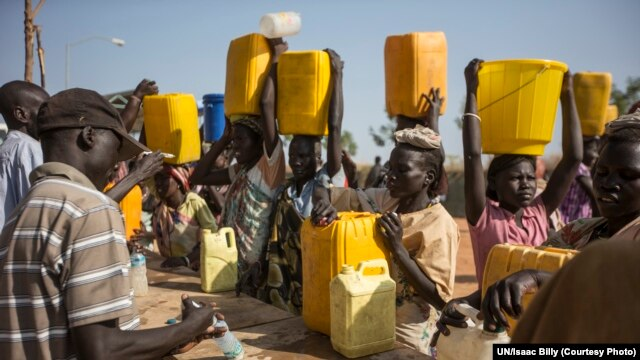 Chlorine is added to water that displaced women fetched from the Nile River during a water shortage at the UN base in Malakal where they are sheltering with thousands more.  Aid groups fear a food shortage at the base unless fighting ends.