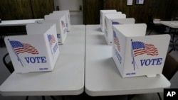 FILE - Voting booths await voters in Red Oak, Iowa.