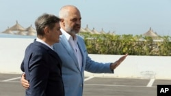 Albanian Prime Minister Edi Rama , right, welcomes Bosnia and Hercegovina's counterpart Denis Zvizdic during an an informal meeting of Western Balkans countries in the Albanian port city of Durres, 33 kilometers (20 miles) west of the Tirana.