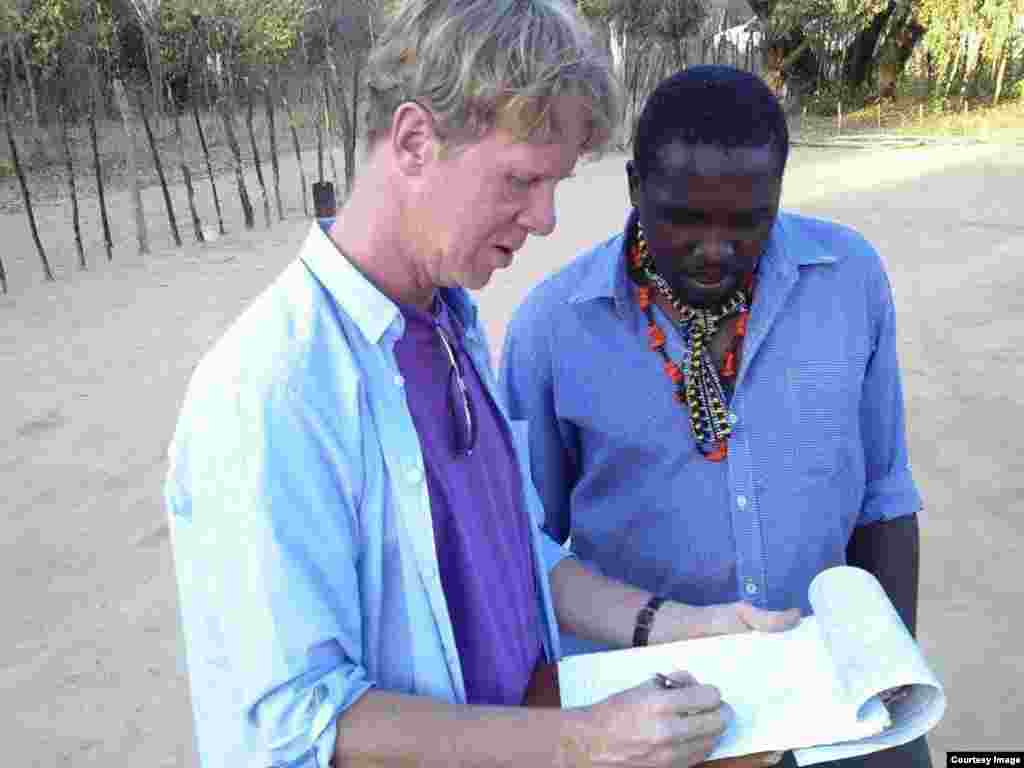 Adjudicators consulting during the mud hut decoration competition in Matobo, Matabeleland South Province, Zimbabwe