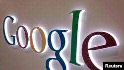 A Google sign is seen at a Best Buy electronics store in Encinitas, California, Apr. 11, 2013.